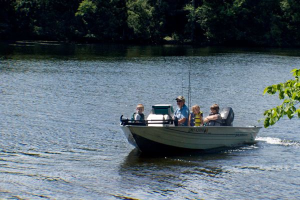 Fishing from a motorized boat on Lake Carmi.