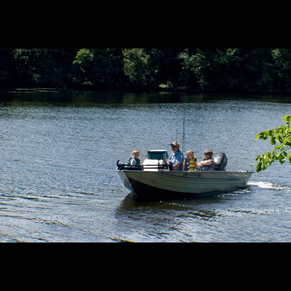 Fishing out of a motorized boat on Lake Carmi.