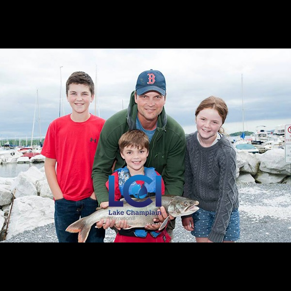 A happy family with a lake trout in the 33rd Annual LCI Derby.