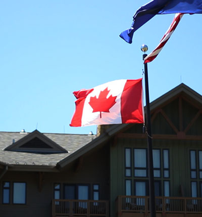 Canadian flag flies at Stowe Mountain Lodge in Stowe, Vermont.