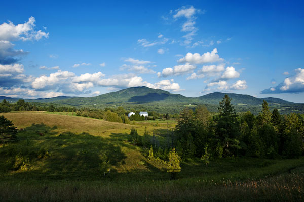 A typical Vermont summer scene - green hillsides underneath a blue sky.