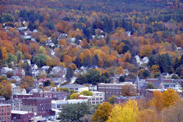 Foliage surrounds Barre. Photo Credit Jeb Wallace Brodeur.