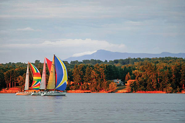 A group of sailboats on a lake. Photo Credit Jeb Wallace Brodeur.