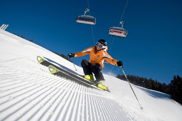 A skier enjoys a freshly groomed trail ride.