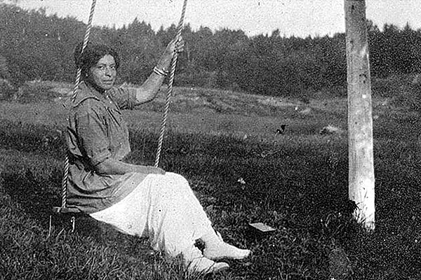 Woman on a swing at Journeys End Birchdale Camp