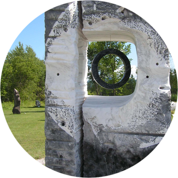 a sculpture made of marble in the shape of a circle enclosed in a rectangle