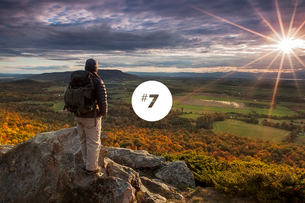A hiker enjoys the view from a Vermont mountain summit