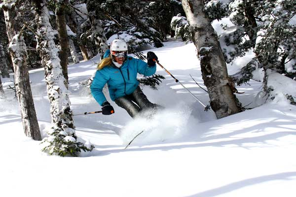 A Skier enjoys the powder during a Vermont Ski Getaway.