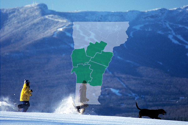 Central Vermont overlay on people running in the snow with their dog.