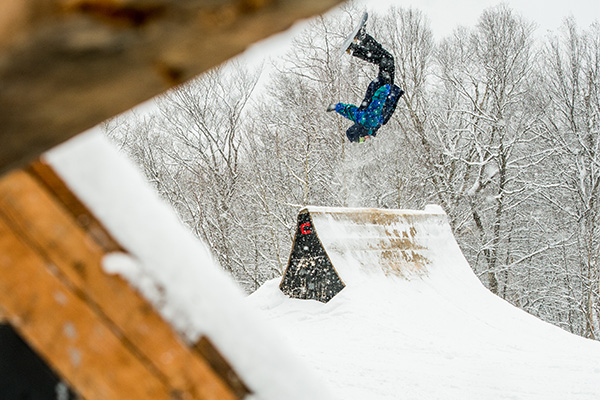 A skier takes a run down the terrain park at Mount Snow Resort.