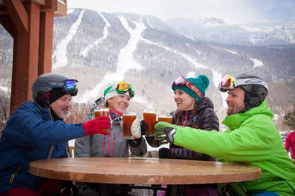 A family enjoys a beer between runs at Stowe Mountain in Stowe, VT.