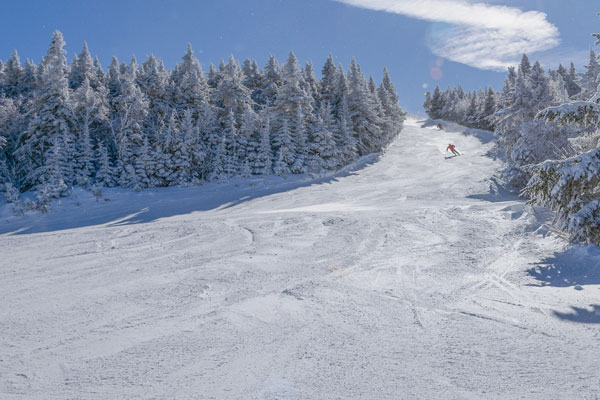 A person ski's down a trail at Stratton Mountain Resort.