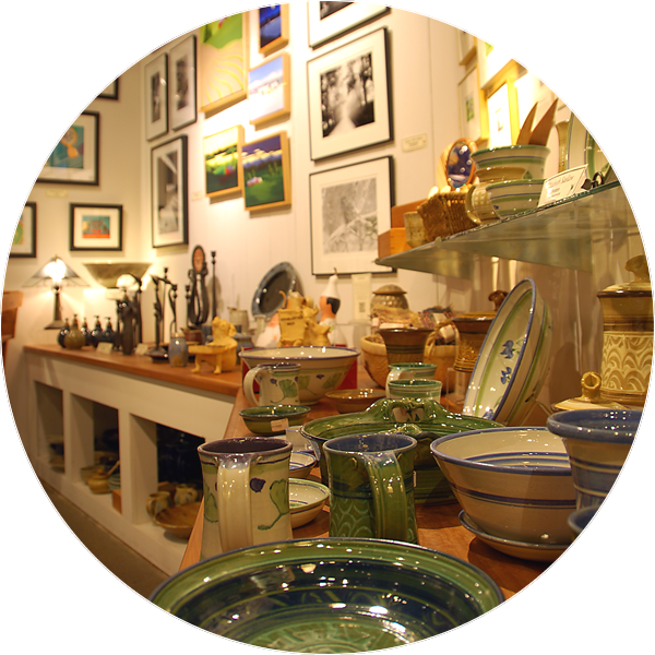 gallery interior showing pottery, photographs and prints for sale